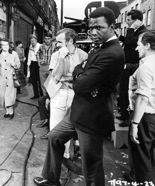 Sidney Poitier and director James Clavell (right) between scenes of To Sir, with Love (1967).
