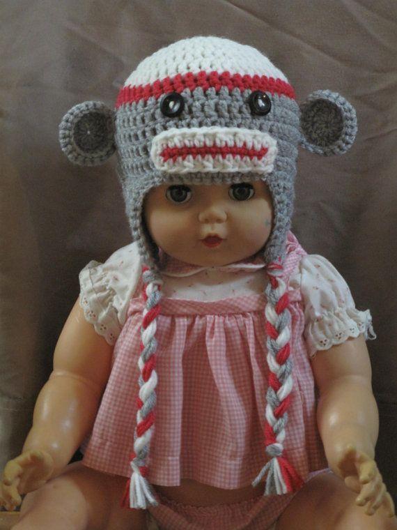 Eeeee!  Sock monkey hat!   Buy for Jody/Alexis/Charlotte for sure - maybe Andy?