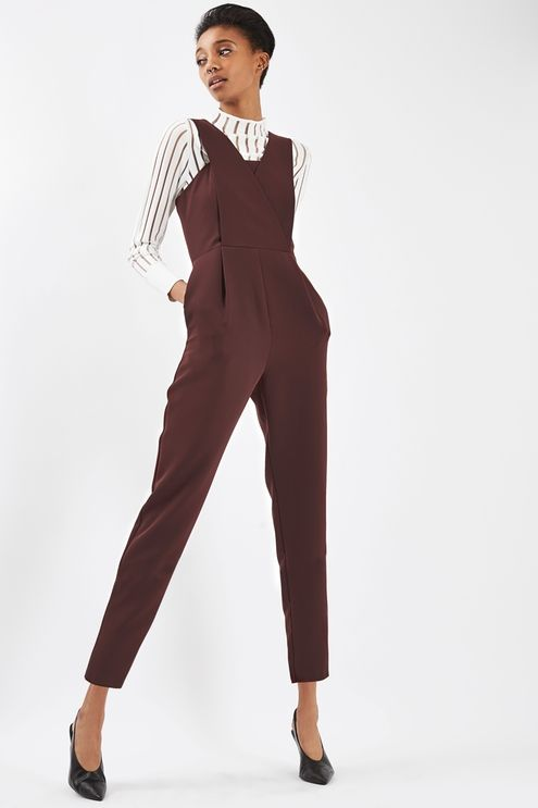 Perfect your all-in-one look with this pini-style jumpsuit in deep berry. With a cool cross-strap design to the front, it also comes with a tapered leg and is perfect layered over a long sleeve striped tee. #Topshop