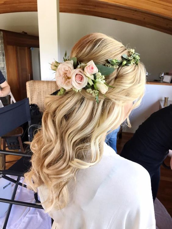 Romantic wavy half up half down hairstyle with gorgeous blush roses floral crown…