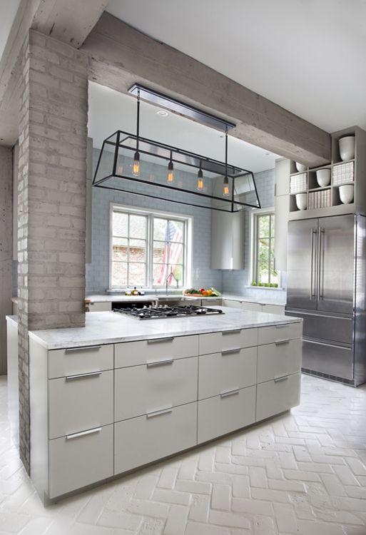 Herringbone brick floor + soft palette + historical beamwork + modern lighting in kitchen by Ty Larkins