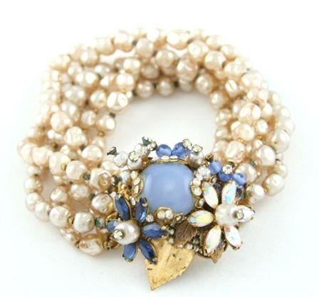 vintage Chanel (or...fasten a vintage brooch onto a multi-strand bracelet)