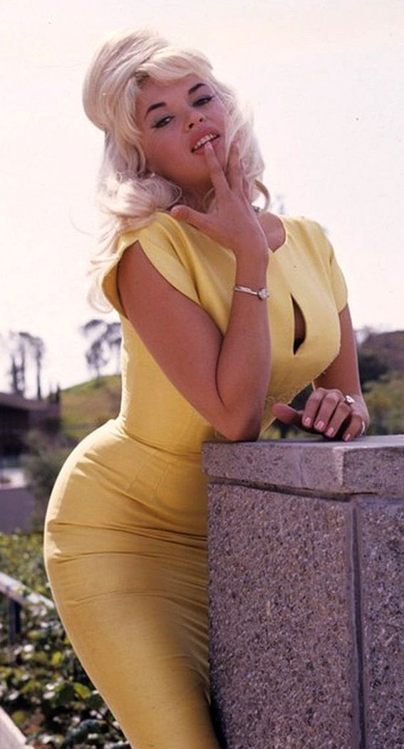 Jayne Mansfield during the production of Primitive Love in 1964. 50s 60s gold yellow wiggle dress close up photo print ad promo model magazine movie star