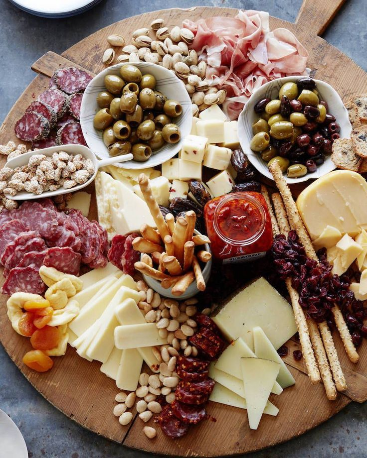 Appetizer plate: cheese, sausage, olives, grissinis, dips, peanuts, …
