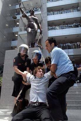 A Turkish lawyer being beaten by the police beneath the feet of Themis. This photo will most probably become one of the symbol images for the Turkish protests of 2013.