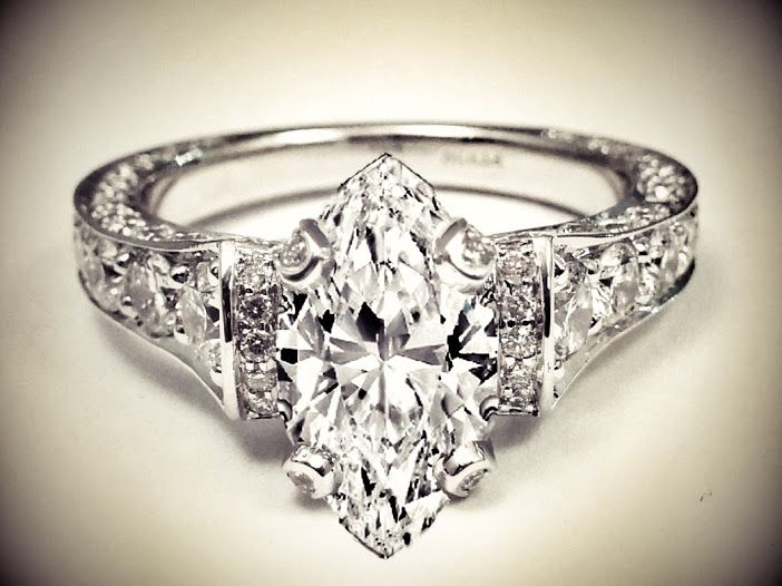 Large Marquise Diamond Cathedral Graduated pave Engagement Ring