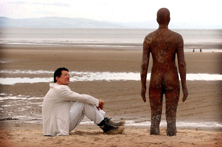 Artist Antony Gormley at the launch of Another Place on Crosby beach