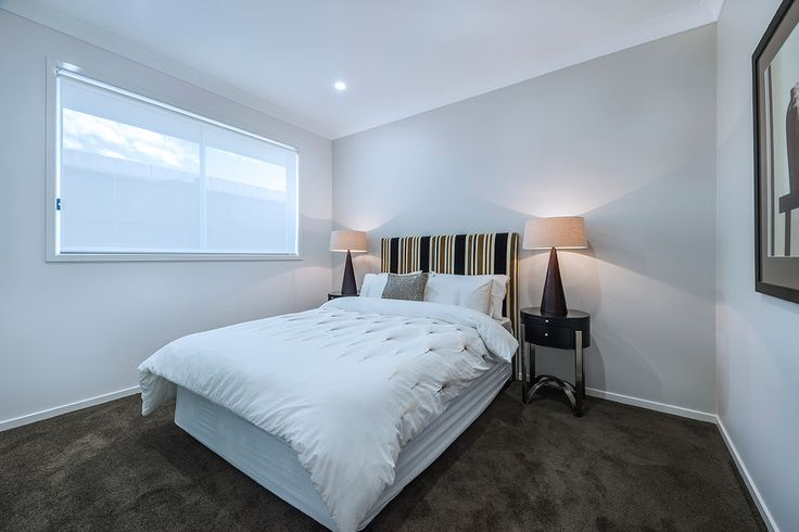 #Bedroom #interior #design #inspiration from #Ausbuild's Bellfield display home. This #bedroom features soft #espresso carpet combined with a soft grey feature wall and an #African #inspired #stripped #bed #head.