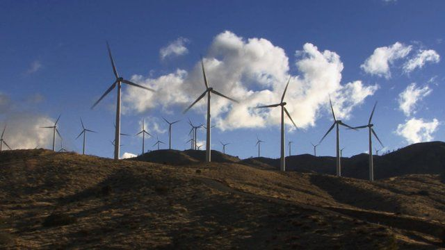 Stock footage - http://www.alunablue.com - royalty free stock footage for broadcast, corporate promotions and all multimedia productions.   Wind Turbine 3011: Wind turbines turn against time lapse clouds.   A Luna Blue Stock Video.  Imagery for Your Imagination.