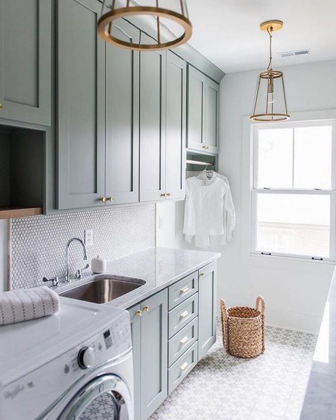 BECKI OWENS - Pinterest Top 10 - Visit the blog to see the top trending images on my boards this month! Like this pretty green gray laundry with brass pendant lighting.