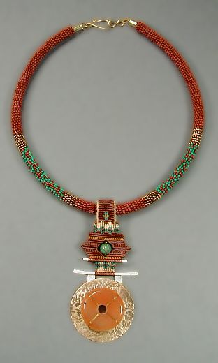 """""""Santa F'Asian Necklace""""    Collar is wrapped seed beads and is 18"""" long. An ornament of hammered brass and silver with a carnelian stone is hung from knotted nylon cord with a turquoise bead at center. Pendant is 3.5"""" long.    Price 450.00    Item #J-P8310015    Contact me about availability."""