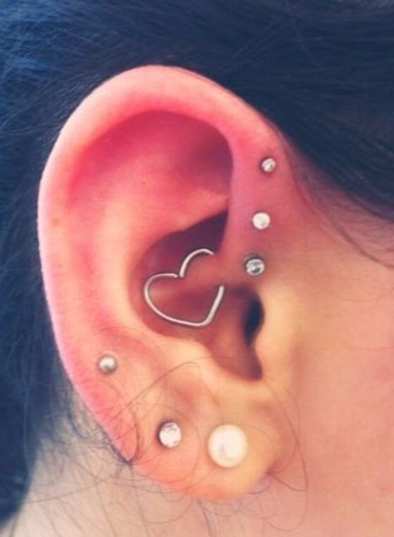 Love the three small studs on the front of the ear..... the heart piercing, not so much!