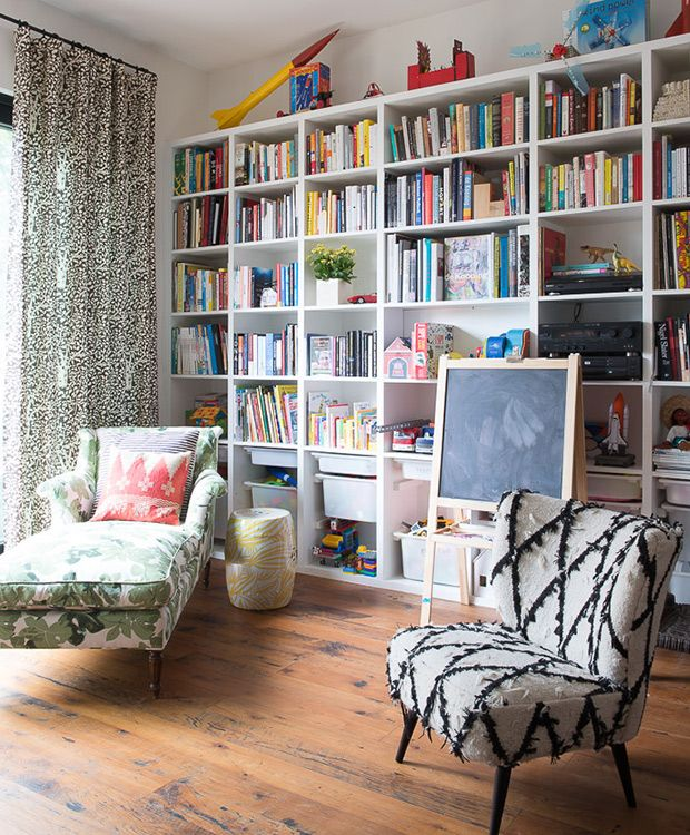 Tall built-in shelves with toy storage installed at the bottom. A chaise is a cool idea too.