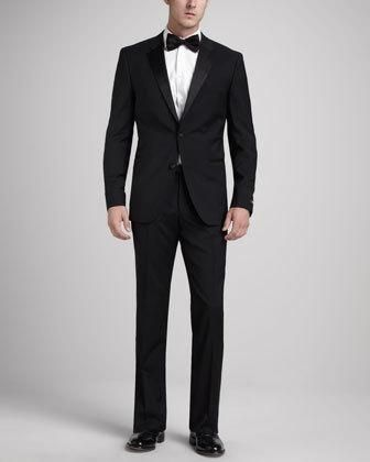 The Hugo Boss Stars/Glamour tuxedo updates timeless black tie style with a slim modern fit. Two-piece set. Satin piping and satin-covered buttons. Satin notched lapels; two-button front.... More Details