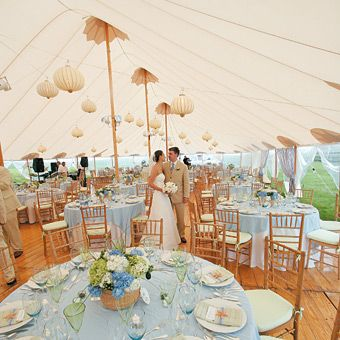 Brides: Blue and White Tent Wedding Decor . The blue-and-white color scheme came together at the reception where all of the tableware and linens were rented from Party Rental Ltd.