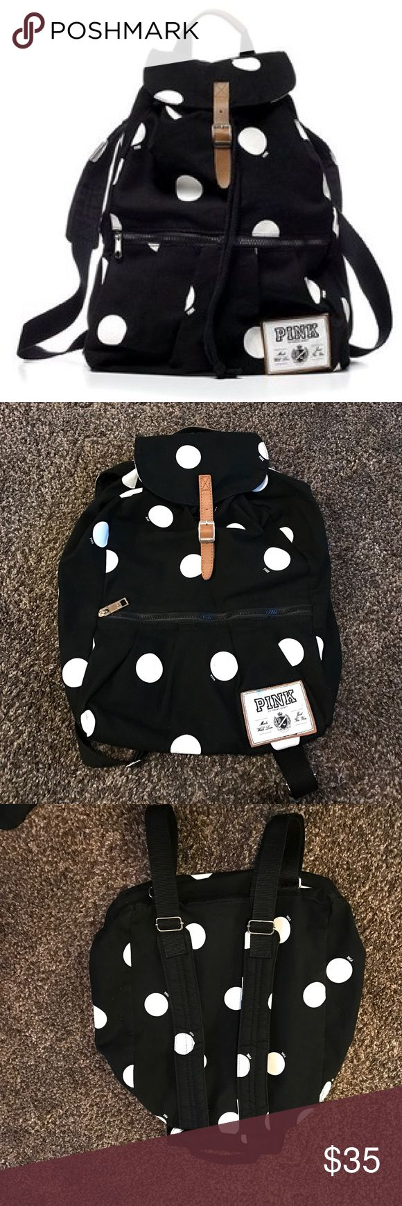 Pink by VS black and white polka dot backpack This backpack is so amazing with an adorable pattern and has only been used a handful of times so it is in great condition! The only flaw this has is a blue pen mark one the PINK label, but this may come out by washing the backpack! PINK Victoria's Secret Bags Backpacks