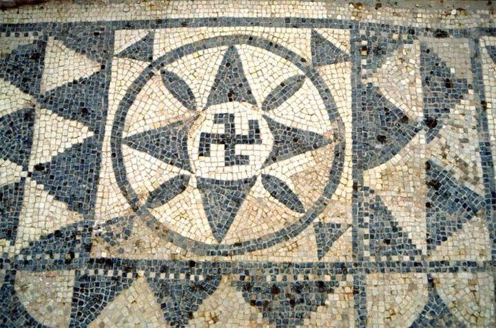 http://en.wikipedia.org/wiki/Sabratha , http://en.wikipedia.org/wiki/Yamdrok_Lake    The oldest known swastika