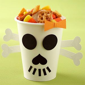 Skull Treat Cup - This skull treat cup looks much harder than it is, thanks to clever use of paper-punched shapes. Punch the circle eyes, a heart nose, and cut out small rectangles to create this skull's face; adhere to the cup. Attach four punched hearts to the ends of two strips of white card stock. Crisscross the strips of card stock and adhere them to the back of the cup.