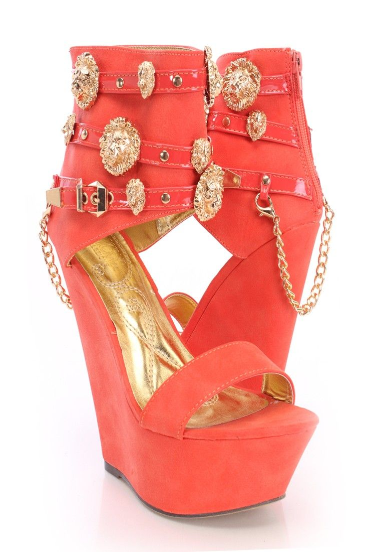 Walk with confidence and style next time you arrive at your next party! Pair these awesome wedges with a sexy faux leather mini skirt and a caged crop top to finish off your ensemble. This style features a faux leather upper, wide ankle strap with lion head pendant accent, peep toe, dangle chain heel detail, strap vamp, ankle zipper closure, stitched, smooth lining, and finished with a cushioned foot bed. Approximately 6 inch Wedge Heels 2 inch Platform.