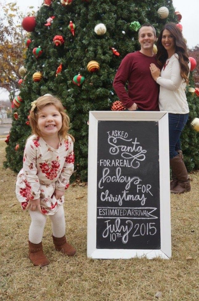 If you're having a second baby, have the new big brother or sister pose with their Christmas wish list.