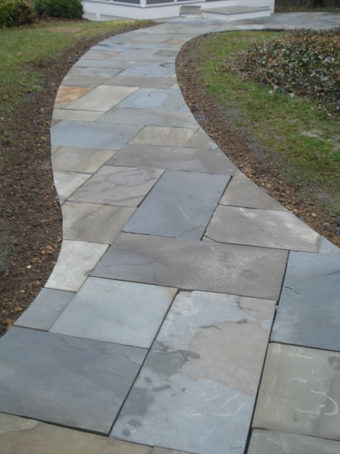 Flagstone Walkway Leading To Outdoor Lifestyle