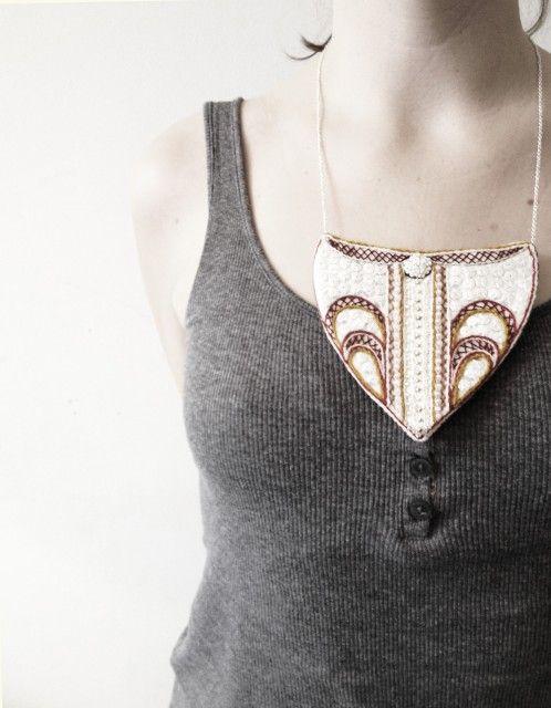 Necklace. Embroidery   Halssmycke. Broderi på vadmal, pärlor och paljetter, silver i kedja om halsen.