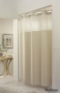 Want this tall shower curtain and round rod! Great idea to improve the overall look of the bathroom