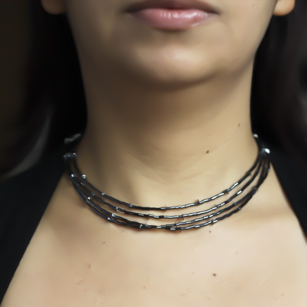 Gorgeous, authentic, beautiful  necklace.  Handmade from bugle beads and silver plated findings.