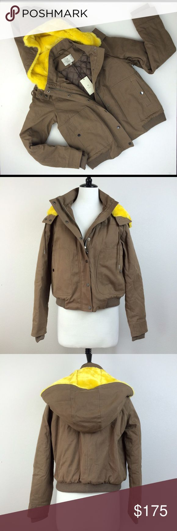 """NWT Essentiel Antwerp Brown Parka NWT Essentiel Antwerp Brown Parka with Yellow fur hoodie. Quilted lining. Shoulder 15.5"""". Length 23"""". Sleeve length 27"""". Zipper and snap closure. Two side pockets with snap button closure. Size 38 fits like size S. Nasty Gal Jackets & Coats"""