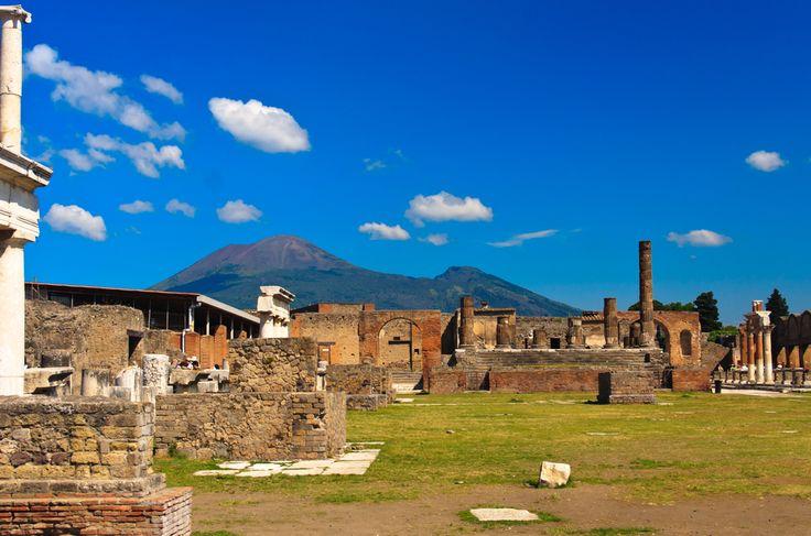 Ruins of Pompeii with Mount Vesuvius in the background.