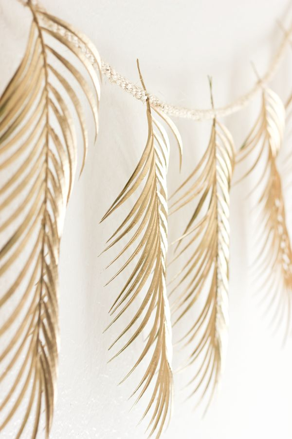 DIY palm frond garland. The perfect way to bring a touch of summer into your home all year round. The gold paint adds some extra glimmer.