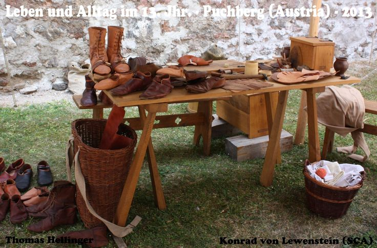 The shoemaker on a living history event. International reenactor meeting 2013 on Castle Puchberg near Vienna - Austria