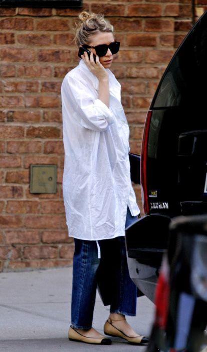 Ashley in a white boyfriend shirt with chic cap toe ballet flats