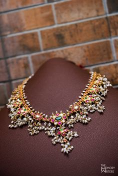Real Indian Wedding - Sowmi and Shiv | WedMeGood | Emerald, Ruby and Pearl Gold Necklace with Pearl Droplets  #wedmegood #indianwedding #indianbride #indianjewlery #jewelry #necklace