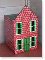 Create a groovy toy house from an old cardboard box and Resene testpots.