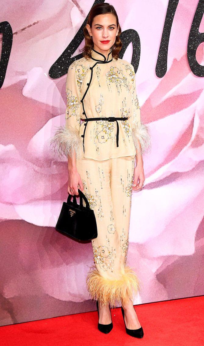 Alexa Chung in a Prada mandarin-collar jacket and feather-hem pants at the 2016 British Fashion Awards