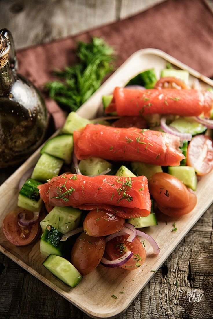 Smoked Salmon With Fresh Vegetables. A sophisticated take on chopped salad, topped off with slices of smoked salmon.