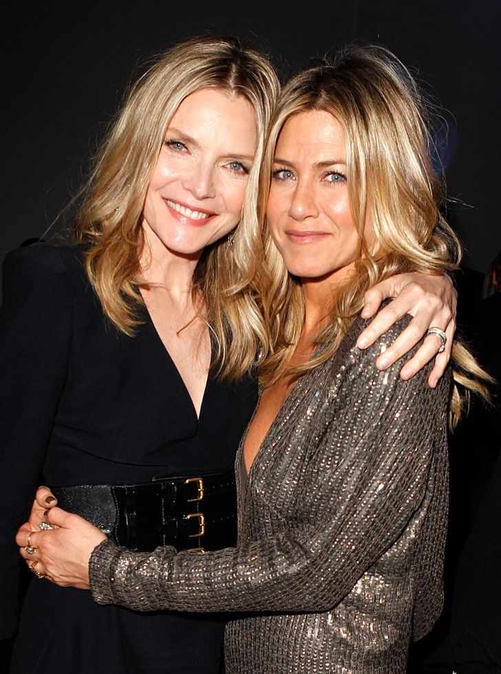 Pin for Later: Birthday Girl Jennifer Aniston's Got More Famous Friends Than We Can Count  Jennifer hugged Michelle Pfeiffer at the Elle Women in Hollywood event in October 2011.