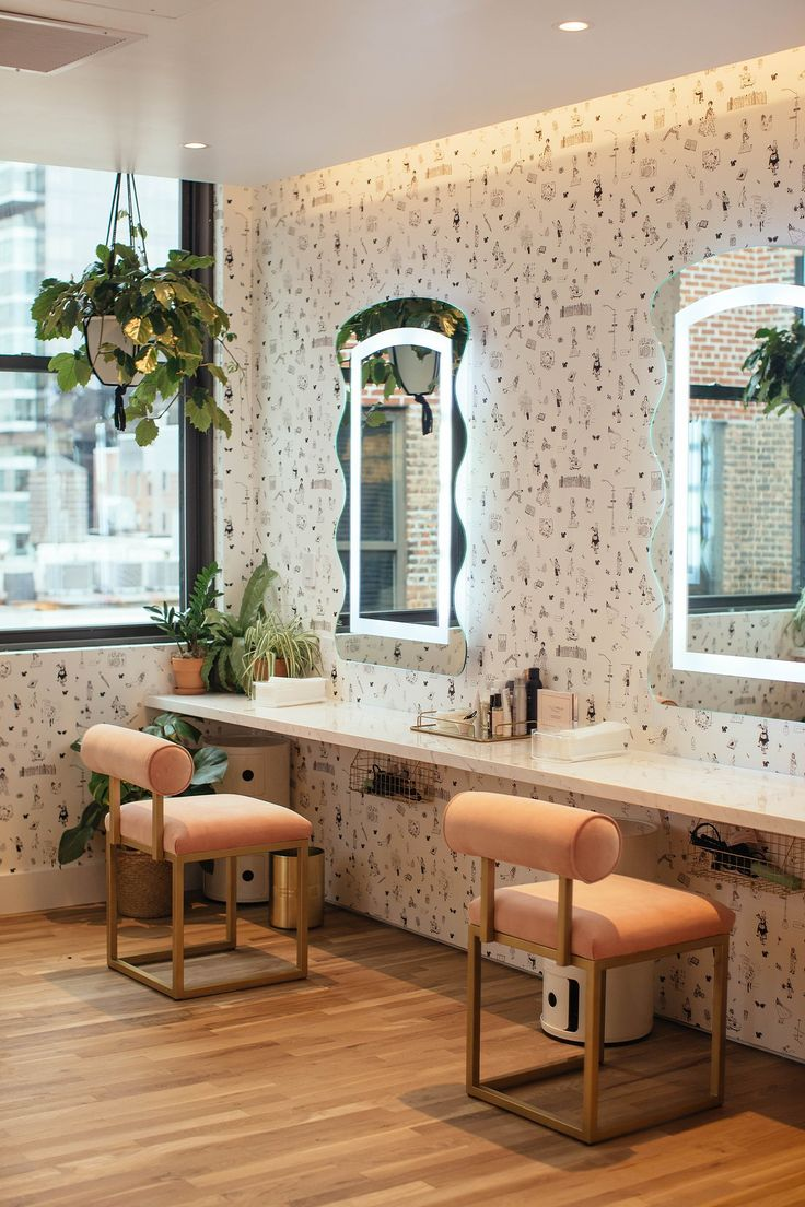 """Our beauty room with a custom wallpaper created by Payton Turner and Joana Avillez, two founding members. As a group we came up with the idea of a toile of busy New York women running from thing to thing, in meetings, at yoga, picking up their daughters, walking their dogs, trying to not get trapped in a rainstorm."""