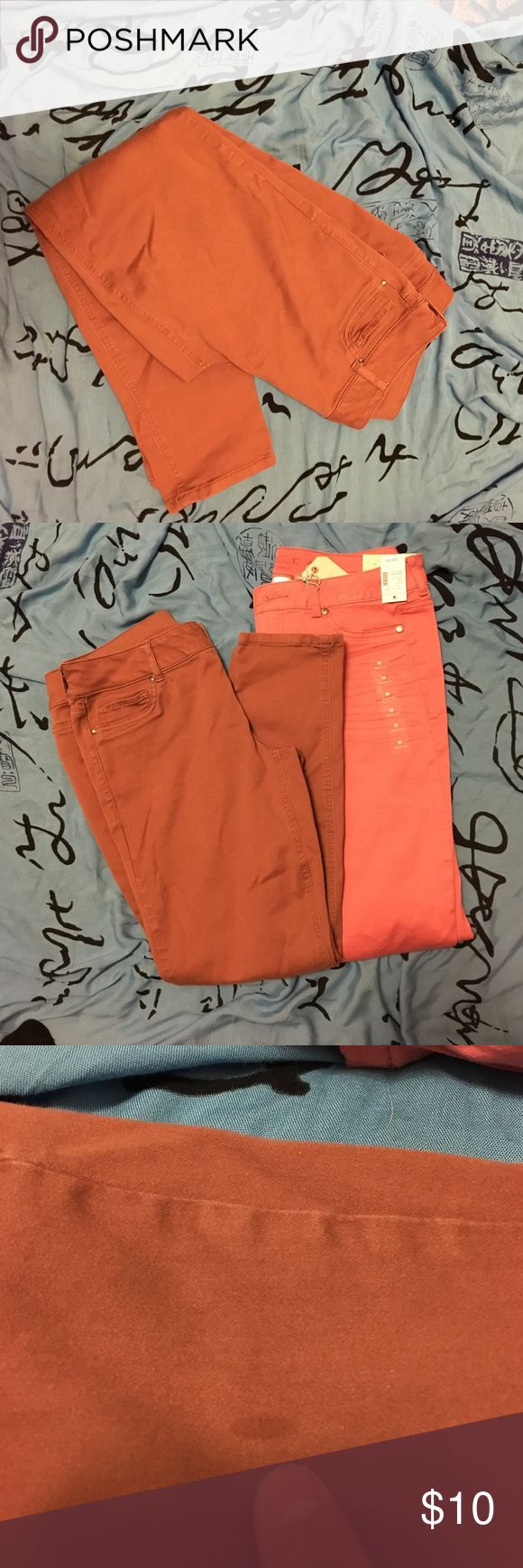 """Maurice's jeggings Bought these thinking they were pink based on stock photos. Much more of a pink-tinged brown or stone color. True pink pair shown for comparison. 17"""" waist 27"""" inseam (""""short"""" fit) with stretch. Small stain on pant leg, condition may improve with cleaning. (I will try a few things and update later). Otherwise in great preloved condition. False front pockets, true back pockets, zippered/button closure, skinny fit. Maurices Pants Skinny"""