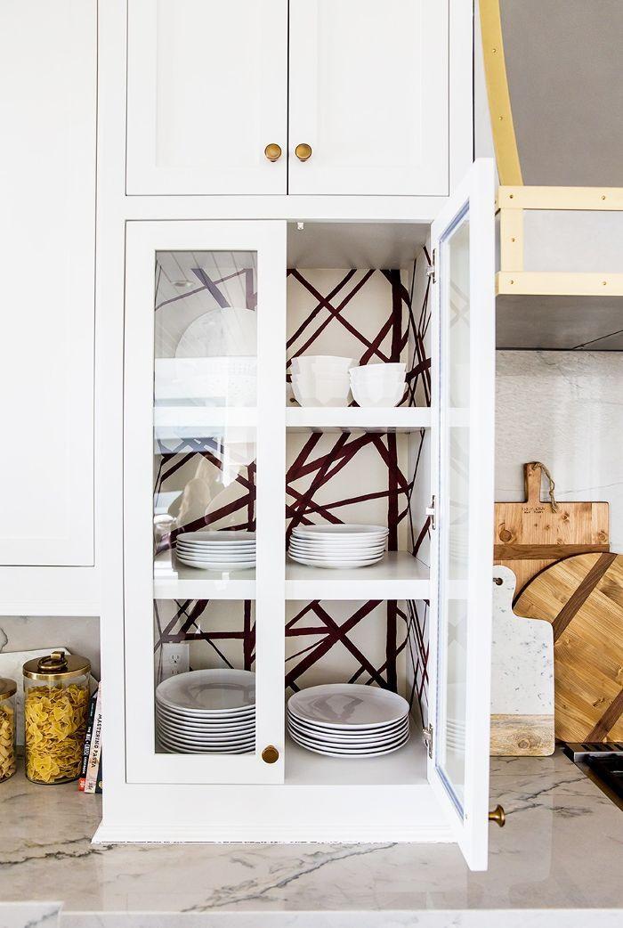 Kitchen details - wallpapered cupboards