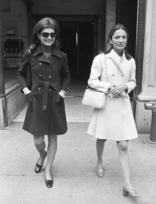 The queens of classic themselves—Jackie O and Lee Radziwill—in perfect wool coats. Photo Credit: WWD