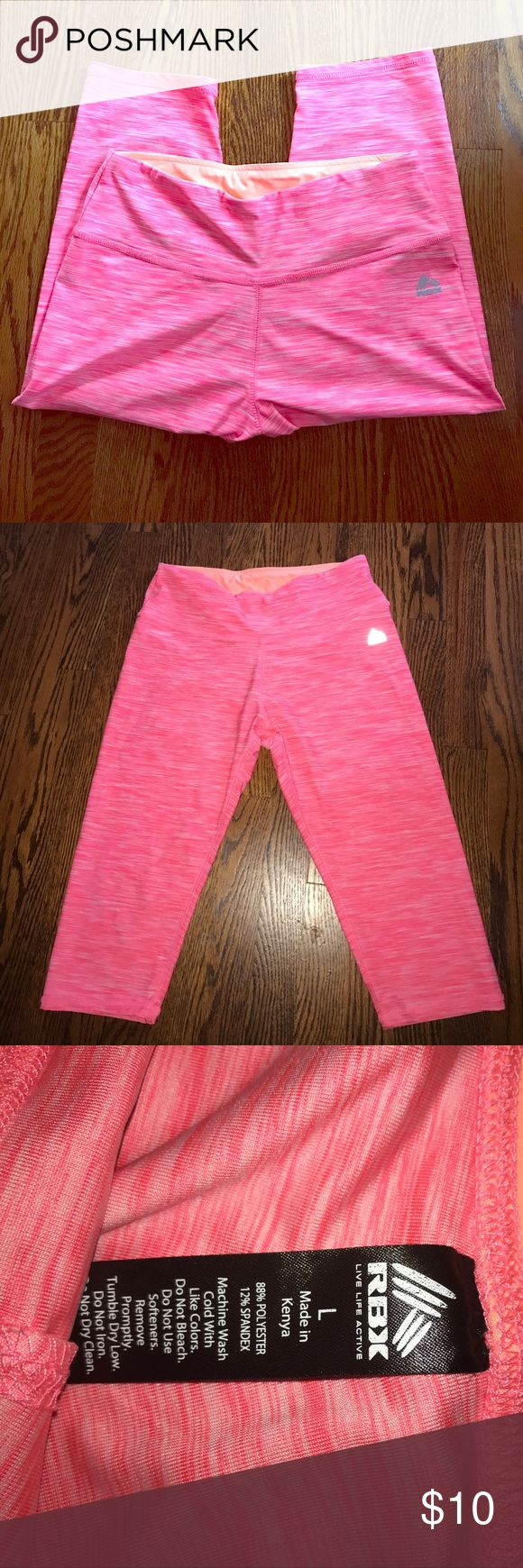 Neon pink cropped leggings Perfect for working out or lounging. Super bright and pretty color. Worn once/no flaws. 88% polyester 12% spandex. I would recommend wearing a light colored panty and you should be good to go. Second picture shows the accurate color RBX Pants Leggings