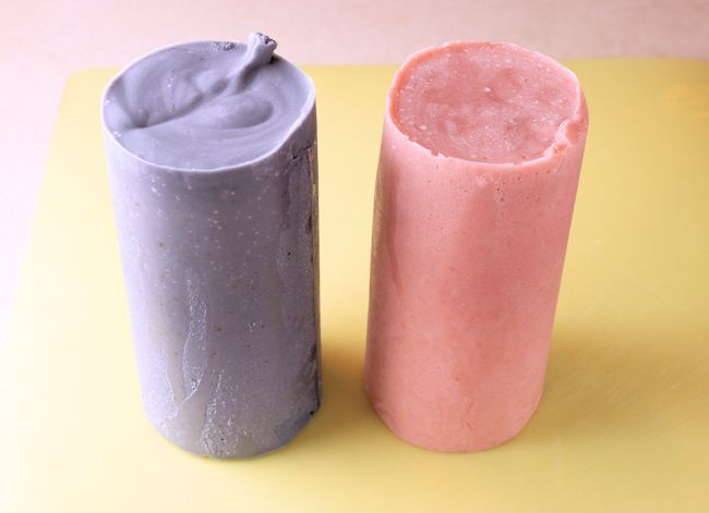 uncut logs of Deep Purple Lavender(L) and madder root(R) colored soaps
