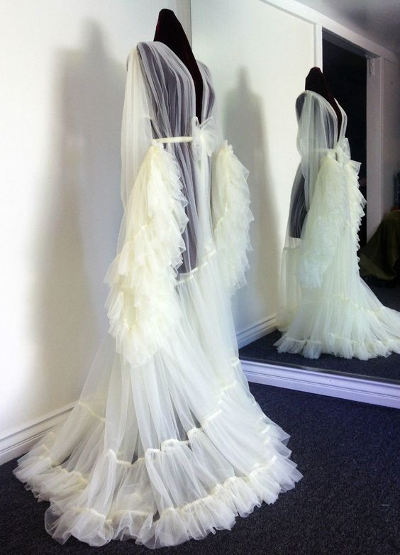 Incredible, floor-sweeping sheer white gown.