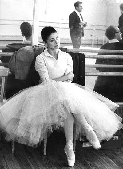 Margot Fonteyn: Prima Ballerina relaxing during rehearsal (Frederick Ashton can be seen in the mirror)