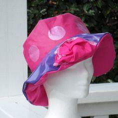 Chapeau de pluie créateur enfant mauve et rose doublé en coton rose
