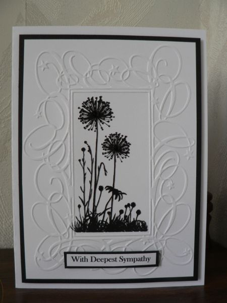 Keep Sympathy cards nice and simple, clean and elegant - this is a beautiful one from Eileen on Card Making World - simple embossing and a black inked stamp.