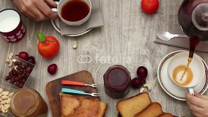 TOP VIEW OF COUPLE HAVING BREAKFAST WITH TEA