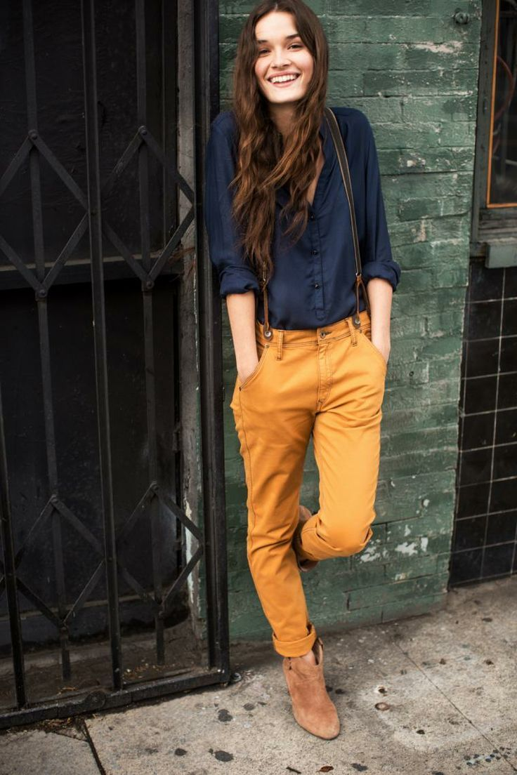 dark blue buttoned blouse, reddish brown chinos, beige suede ankle boots, olive suspenders for